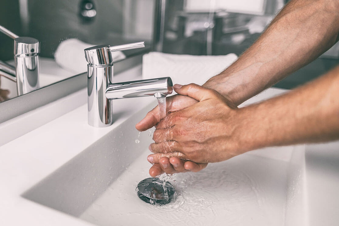 A close-up of a man washing his hands